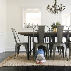 Totally in love with @_heather_moore stop by and visit her gorgeous feed! Love this dining room and that little bundle under the chair! #followfriday