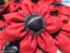 Red posies bridesmaid brooches