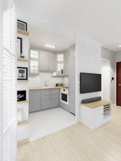 Malutką kuchnię bez okien rozjaśnia biała podłoga oraz jasne szare szafki. Dodatkowo, by nadać wnętrzu charakteru i...