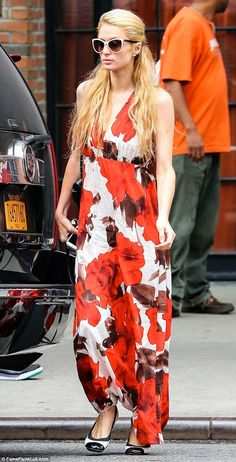Flower power: Paris Hilton looked lovely in a floral maxi dress as she pulled up outside T...