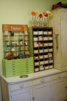 Sewing Craft Room Creative Space Organization with vintage touches. Love the toy trucks with twine.