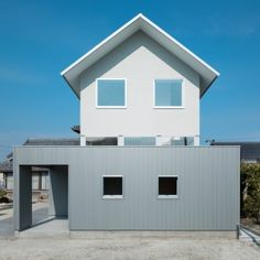Shuhei Goto's Floating House in Ogasa features two-tone cladding and a 360-degree window