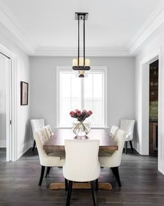 Neutral and wood tones add elegance and style to this small dining area Dark Wood Floors Living Room, Grey Walls Living Room, Dining Room Walls, Dining Room Design, My Living Room, Dark Flooring, Dining Room Windows, Design Kitchen, Grey Walls White Trim