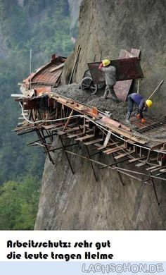 The 21 builders are working in dangerous conditions to build China's longest sightseeing mountain road in Pingjiang county, Hunan Province Dangerous Roads, Scary Places, Jolie Photo, Paths, Cool Photos, Beautiful Places, Beautiful Buildings, Funny Pictures, Random Pictures
