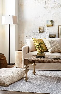 Annalise Living Room - Loving the look and that funky rattan/bamboo coffee table!