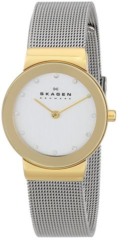 Skagen Ladies Two Tone Watch With Silver Dial Timeless ladies watch. Signature Skagen stainless steel mesh bands connect to a slim, gold plated brushed case with a gold tone mirror border. The dial is accentuated with crystals on hourly marks Elegant Watches, Beautiful Watches, Beautiful Ladies, Emporio Armani, Daniel Wellington, Skagen Watches, Women's Watches, Bering, Rolex Women
