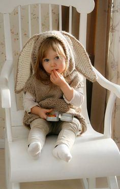This is knitting pattern for poncho Phoebe with a hood and pocket. The pattern includes instructions for making a simple shaped hooded poncho or cute lop-eared bunny poncho with a fur tail. Knit this poncho in cotton+silk for sun protection in summer or in alpaca for layering on colder