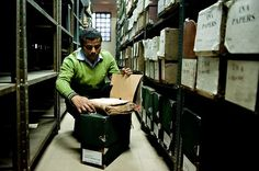National Archives of Inda: An employee removes historical documents from an old storage facility