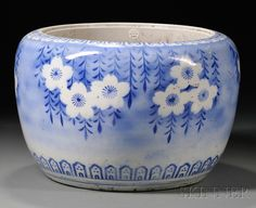 BLUE AND WHITE HIBACHI, JAPAN, LATE 19TH CENTURY, TRANSFER PRINT OF CHERRY BLOSSOMS WITH LAPPET AND STYLIZED LOTUS BORDERS