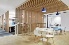 Continuing the wooden screen up onto the ceiling as a way to define a space Case Meallin office design Melbourne Like the wood as an architectural element of the space.