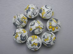 Yellow and gray drawer knobs