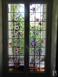 Lizbette painted irises on her mother's bedroom windows so Mama was never without her favorite flower.