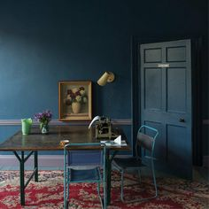 A beautiful old Persian rug with blues and reds could be the starting place for a room that incorporates deep, moody blues, says designer Michael Roberson. This room gets a nice, strong dose of Farrow & Ball's Stiffkey Blue paint. Farrow Ball, Dark Walls, Blue Walls, Dark Interiors, Colorful Interiors, Stiffkey Blue, Sweet Home, Interior And Exterior, Wall Colors