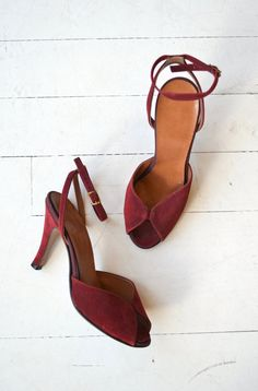 Vintage 1970s wine suede heels with open toe and ankle strap.  ✂-----Measurements  fits like: us 6 | euro 36 | uk 3.5 insole: 9.25 ball: 3 heel: 3 brand/maker: n/a condition: excellent  ➸ more vintage footwear http://www.etsy.com/shop/DearGolden?section_id=5800174  ➸ visit the shop http://www.DearGolden.etsy.com _____________________  ➸ blog | www.deargolden.com ➸ twitter | deargolden ➸ facebook.com | deargolden