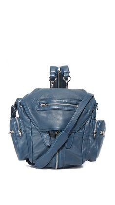 A wraparound center zip provides adjustable volume to this supple Alexander Wang backpack. 5 exterior zip pockets. Snap-tab top flap. Buckle-strap top and lined, 1-pocket interior. Adjustable shoulder straps and optional cross-body strap. Dust bag included.