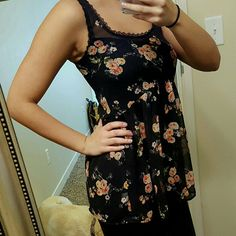 Kirra Sheer Tank Black floral sheer tank top. Tight at bust then flowy, very flattering. Brand is Kirra. Size XS. True to size, tighter in bust area. Cute top! Kirra Tops Tank Tops