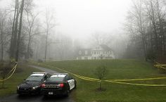 Police cruisers are stationed Tuesday outside the home of Nancy Lanza, where she lived with her son, Adam Lanza, in Sandy Hook, Conn. Nancy ...