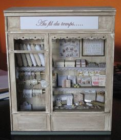 Miniature fabric and lace shop.
