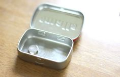 Use an Altoids tin with a neodymium magnet inside for a traveling pin & needle box. BUT KEEP MAGNETS AWAY FROM LITTLE ONES and your credit cards, also.
