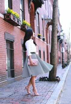 Jean Wang is wearing a white shirt with black dots from from Ann Taylor and a black and white striped skirt from Chicwish