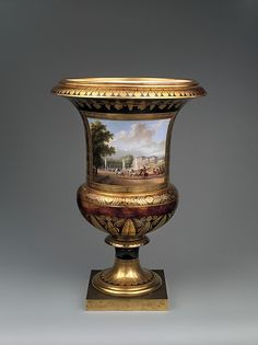 Medici vase with a scene of the château at Saint-Cloud (one of a pair) - Sèvres Manufactory (French, 1740–present), Jean François Robert (French, Chantilly 1778–1832) - Commissioned by Napoléon Bonaparte (French, Ajaccio 1769–1821 St. Helena) Date: 1811, French, Sèvres, Hard-paste porcelain, gilt bronze, Dimensions: Overall (confirmed): 27 1/4 x 18 1/2 x 18 1/2 in. (69.2 x 47 x 47 cm)