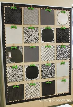 Using clothespins, scrapbook paper and ribbon to make a great display for kids' work!