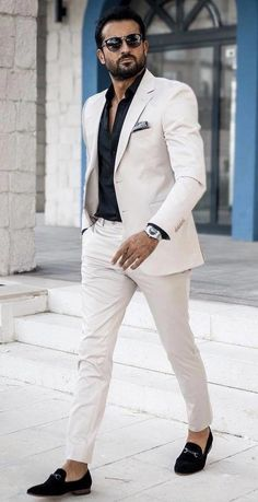 @tufanir - with a smart business casual outfit with a white suit black button up shirt sunglasses black white silk pocket square silver watch no show socks black horsebit loafers  #suit #menswear #gentlemen #classy #menstyle #mensfashion #loafers #smartcasual #businesscasual #MensFashionSmart