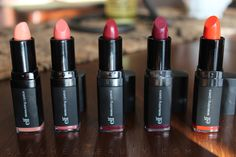 See swatches of the e.l.f. Studio Moisturizing Lipsticks in the shades Wine Tour, Crazy Cranberry, Orange Dream, Party in the Buff and Cheeky.