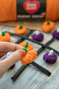 This Halloween Tic Tac Toe yarn pumpkin craft and game is so much fun for kids and easy to make too. Here are instructions and the 3 things you will need.