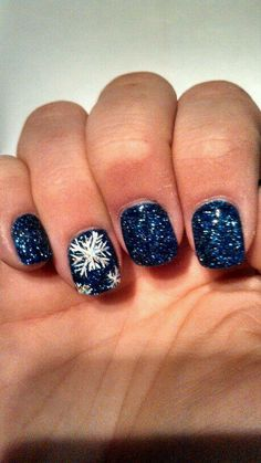 Navy blue glitter polish with white snow flake accent nail