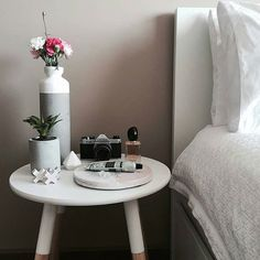Beautiful bedside styling | love the white dipped concrete vase @thedustypoppy