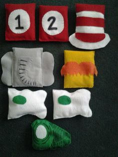 """Dr.Seuss bean bag, toss game, horton the elephant,  the lorax, grren eggs and ham, thing 1 and thing 2, cat in the hat """"hat"""""""