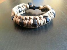 Ridge-back paracord bracelet with black hex nuts.