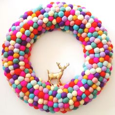 "Colourful Christmas: extra large feltball wreath and garland in ""Rainbow Mix"", AU$125, from Down That Little Lane."