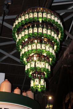 chandelier made of whiskey bottles <3 inside the jameson factory Dublin, Ireland  I never knew how much I liked Jameson until I tasted it from the factory Mmmm