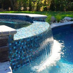 These glass pool tile spillways are a beautiful way to make your pool look gorgeous. It provides for a great setting for your pool fun. Swimming Pool Tiles, Luxury Swimming Pools, Dream Pools, Swimming Pools Backyard, Swimming Pool Designs, Pool Landscaping, Lap Pools, Indoor Pools, Luxury Pools