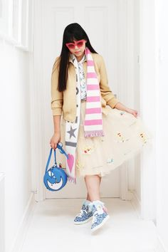 Coach x Gary Baseman leather bomber jacket, Jonathan Saunders glasses, To be Adored shirt, Tsumori Chisato skirt, , TL-180 bag, Ryan Lo scarf, Pum Pum socks, Minna Parikka trainers