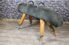 This dark suede vintage gymnastics pommel horse is part of a large range of gym equipment that we are selling. The item is in good condition with a dark suede leather top and sectional design. - See more at: http://www.peppermillantiques.com/vintage-gymnastics-pommel-horse/#sthash.RjnAGQb2.dpuf