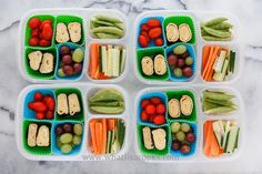 Tamago rolls (Japanese seasoned egg omelette), tomatoes, grapes, cucumbers, carrots, sugar snap peas. Packed in Easy Lunchboxes .