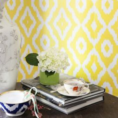 Love the ikat wallpaper with that bright blue bowl.