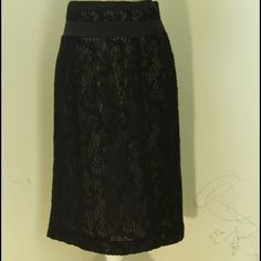 Black lace skirt. Feminine and chic lace skirt with taupe colored lining. Worthington Skirts