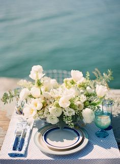 """""""This seaside tablescape was designed with a slightly retro vibe and decorated with loosely arranged spring flowers,"""" said stylist Kelly Oshiro   Photo by Jose Villa"""