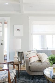 Living Room Makeover By Emily Henderson + Curbly - Featuring Laura Ashley Flat Roman Shades in Casualle Milk.