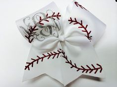 Such a cute hair bow for a baseball sister. Would be cute with brothers number on the tail. Perfect for a softball team, too!