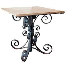 Wrought iron table with marble top.