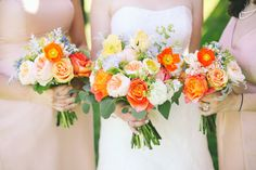 bride and bridesmaids wedding flower bouquets in orange, peach, yellow, and blue, featuring poppies, roses, parrot tulips, scabiosa and textured foliage by www.redpoppyfloral.com