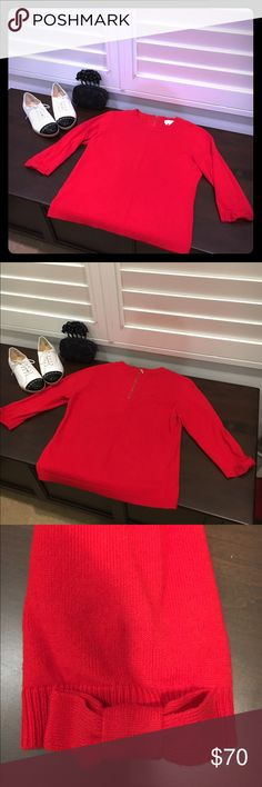 Red Kate Spade Sweater, Size Large Add a tres chic, red Kate Spade sweater to your closet. This fashion staple is soft, comfortable, playful and practical. I love the bow detail on the 3/4 sleeves and gold zipper on the back of the sweater. This sweater is in like new, excellent condition.  Additional details: Size large, pullover style, 90% wool/10% cashmere.  This item pairs well with several of the items I have recently listed. kate spade Sweaters Crew & Scoop Necks