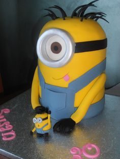 Despicable me Minion - yellow vanilla sponge cake with white ganache filling and covered in fondant. Mini minion made from gumpaste/sugarpaste mix.