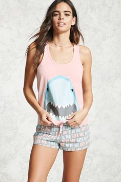 "A PJ set featuring a knit racerback tank with a shark graphic on the front, as well as a pair of heathered knit shorts with an allover ""Bite Me"" graphic print and an elasticized drawstring waist."