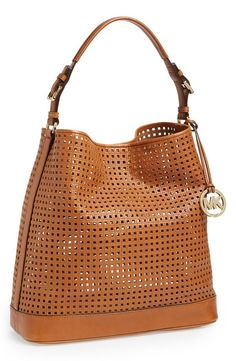 A fresh tote for spring! Love this Michael Kors perforated beauty.